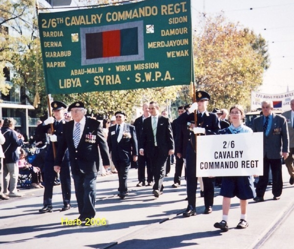 ANZAC DAY 2006 Herb Suttie leads the march.Bill Dobell's granddaughters banner bearers